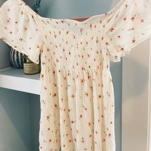 Very cute off the shoulder shirt.